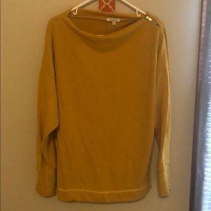 Mustard soft sweater. Zipper on right shoulder.